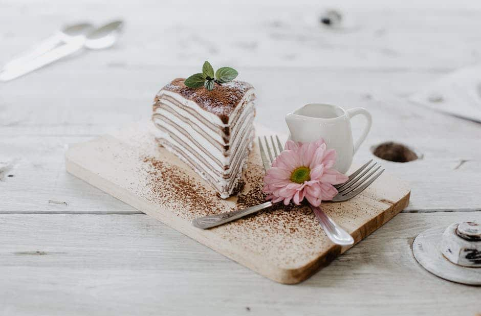 A piece of cake sitting on top of a wooden table